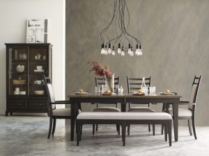 Add intrigue to your dining room with this edgy, industrial style, dark finish dining room set from Kincaid's Plank Road.