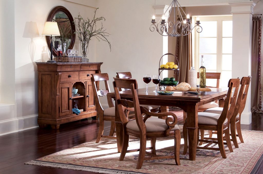 Add a classic and casual style to your Chattanooga dining room with the Tuscano dining room table and chairs set from Kincaid.