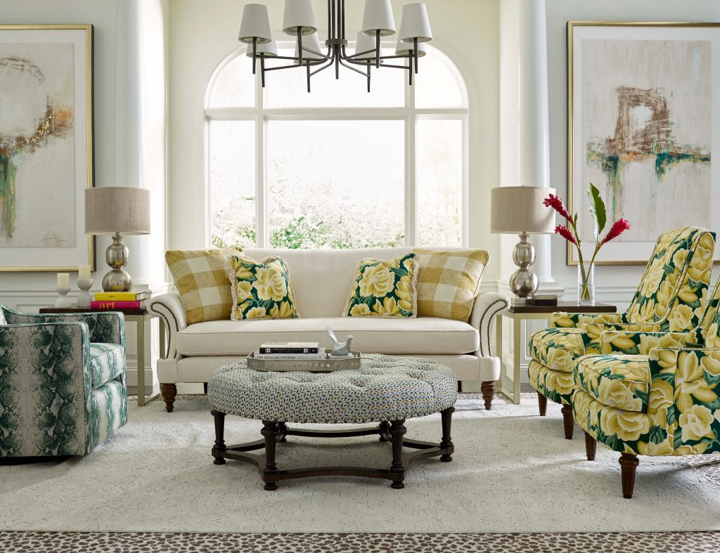 Dress up a white sofa with vintage patterns to create a mood in your Chattanooga living room.