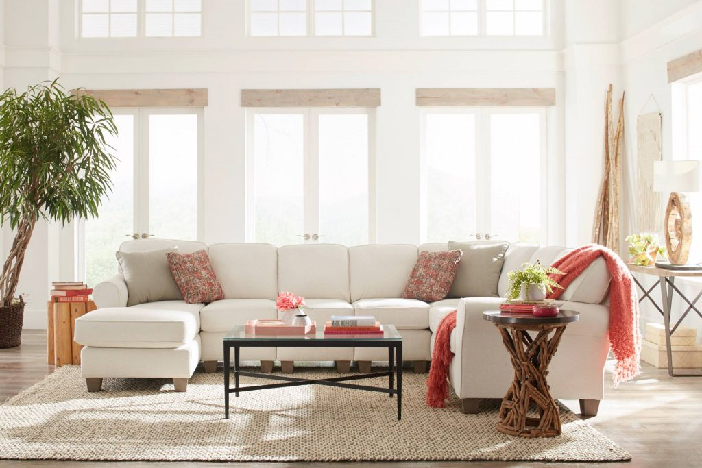 Easily tailor your Chattanooga living room into a feminine space when you start with a white sofa from EF Brannon.