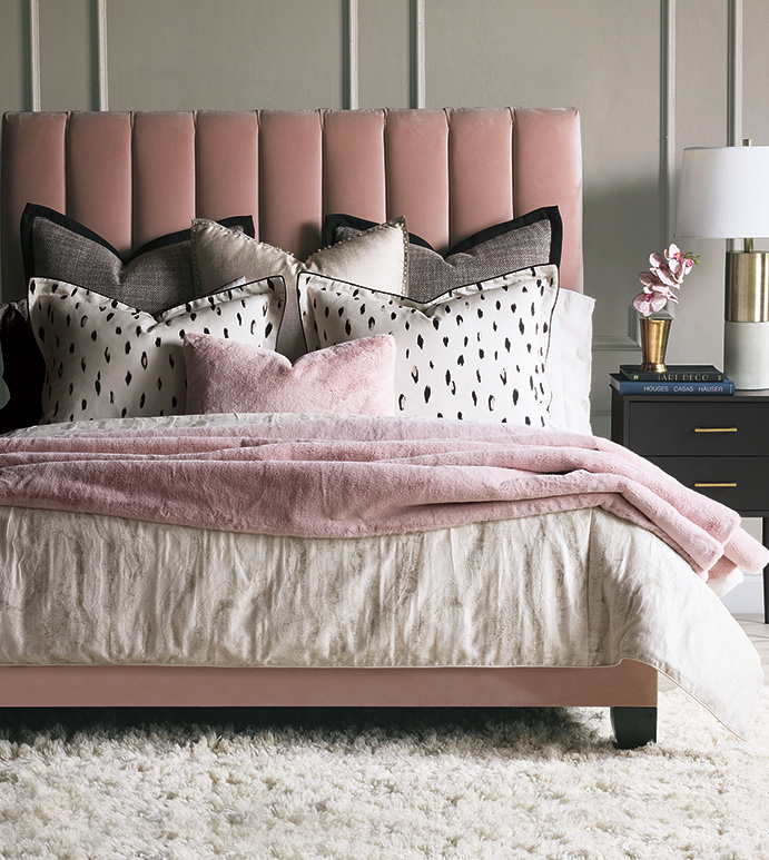 Add a Valentine-inspired feel to your Chattanooga bedroom with modern touches like this pink upholstered bed from EF Brannon furniture shop.