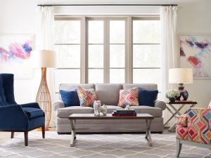 Add pops of color to any room to shake things up– like the reds and pinks in this Chattanooga living room decor!